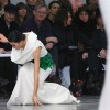 A model falls as she presents a creation by French designer Stephane Rolland as part of his Haute Couture Spring-Summer 2013 fashion show in Paris January 22, 2013