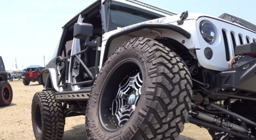 White modified monster Jeep Wrangler unlimited